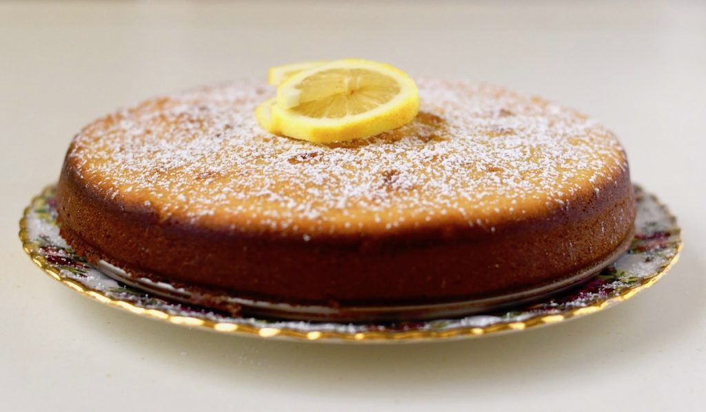 Lemon Ricotta Cake dusted with powdered sugar.